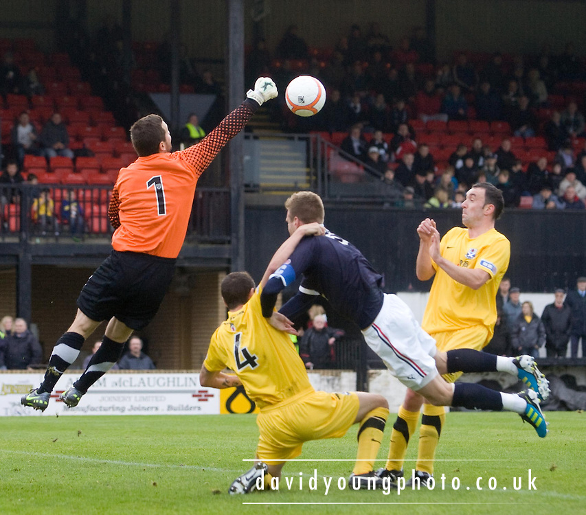Ayr United's John Robertson pulls over Dundee's Rhys Weston to concede a penalty - Ayr United v Dundee, IRN BRU Scottish Football League First Division at Somerset Park..© David Young.5 Foundry Place.Monifieth.Angus.DD5 4BB.Tel: 07765 252616.email: davidyoungphoto@gmail.com.http://www.davidyoungphoto.co.uk
