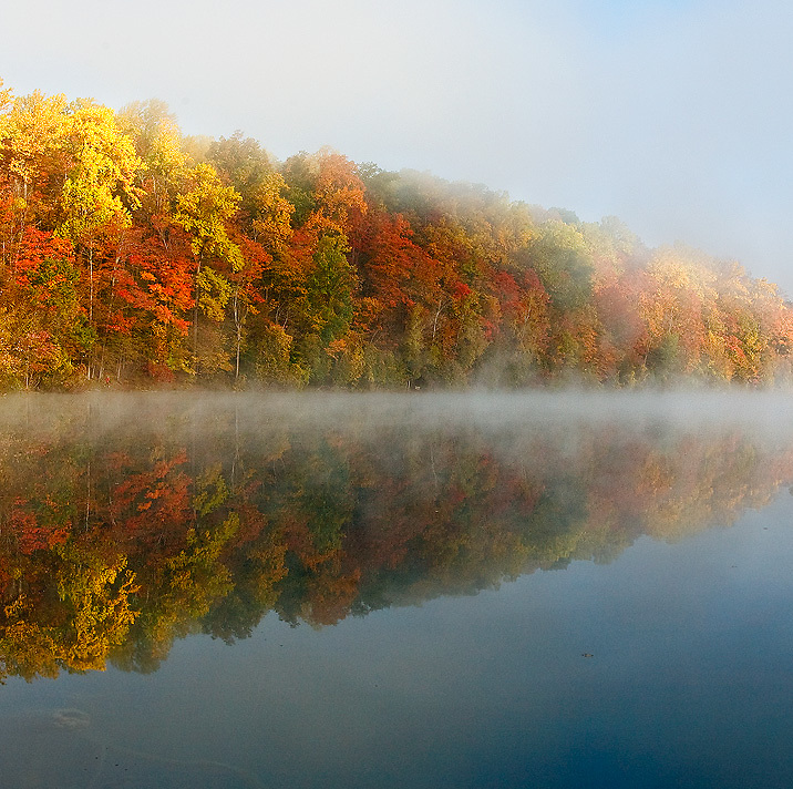 Autumn Foliage Reflections  with Fog at Green Lakes State Park, Syracuse, New York, USA