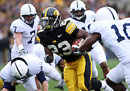 08 NOVEMBER 2008: Iowa running back Shonn Greene (23) tries to get by the defenders in the first half of an NCAA college football game against Penn State, at Kinnick Stadium in Iowa City, Iowa on Saturday Nov. 8, 2008. Iowa beat Penn State 24-23.