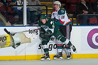 KELOWNA, CANADA - SEPTEMBER 29: Orrin Centazzo #11 of the Everett Silvertips checks Kole Lind #16 of the Kelowna Rockets into the boards during first period on September 29, 2017 at Prospera Place in Kelowna, British Columbia, Canada.  (Photo by Marissa Baecker/Shoot the Breeze)  *** Local Caption ***