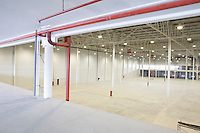 Empty warehouse with red piping