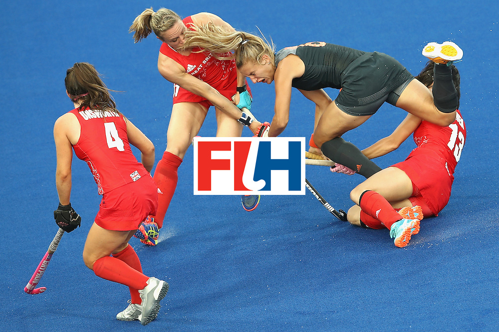 RIO DE JANEIRO, BRAZIL - AUGUST 19: Laurien Leurink of Netherlands is tackled by Laura Unsworth (l) Kate Richardson-Walsh (c) and Sam Quek (r) on Day 14 of the Rio 2016 Olympic Games at the Olympic Hockey Centre on August 19, 2016 in Rio de Janeiro, Brazil.  (Photo by Mark Kolbe/Getty Images)