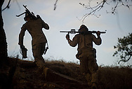 Marines haul their weapons up a steep hill in search of a place to hunker down at dusk during live-fire exercises for the 2nd Battalion, 5th Marine Regiment at Camp Pendleton.<br /> <br /> <br /> ///ADDITIONAL INFO:   <br /> <br /> david.marines.0705.kjs  ---  Photo by KEVIN SULLIVAN / Orange County Register  --  6/28/13<br /> <br /> Live-fire exercises by the United States Marine Corps' 2nd Battalion, 5th Marine Regiment  (2/5) based out of Marine Corps Base Camp Pendleton, California. The 2/5 fall under the command of the 5th Marine Regiment and the 1st Marine Division.<br /> <br />   6/28/13.