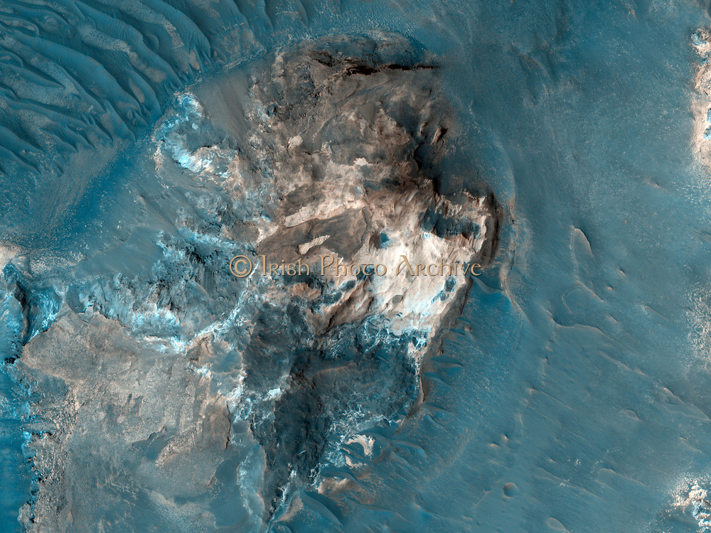 The formation of the large outflow channels on Mars have been attributed to catastrophic discharges of ground water. This is known as chaotic terrain. MRO.