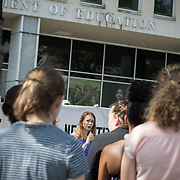 WASHINGTON,DC-JUL13: A rally for survivors of sexual assault and their allies, outside the Department of Education, ahead of a series of meetings that Secretary Betsy DeVos is holding with survivors, advocates for the wrongly accused and college administrators. DeVos is considering whether to rollback Obama-era guidance on handling sexual assault, which victims' advocates credit with improving the situation on college campuses, and which others say has led schools to err on the side of finding students guilty of assault even when they are innocent. (Photo by Evelyn Hockstein/For The Washington Post)