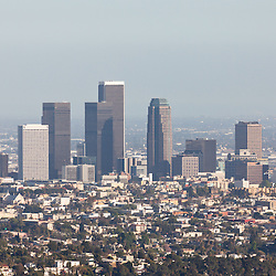 Photo of hazy Los Angeles skyline skyscrapers, office buildings, and aprtment buildings in Southern California in the United States.