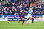 Jason Puncheon of Huddersfield Town (42) passes the ball away from Sead Kolasinac of Arsenal (31) during the Premier League match between Huddersfield Town and Arsenal at the John Smiths Stadium, Huddersfield, England on 9 February 2019.