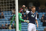 Millwall FC defender Byron Webster (17) praises Millwall FC goalkeeper Jordan Archer (13) after he headed out a poor backpass during the Sky Bet League 1 match between Millwall and Peterborough United at The Den, London, England on 20 February 2016. Photo by Geoff Penn.