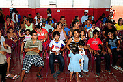 Members of the community of Zamoran, waiting to hear the results of their medical tests carried out by the 'Nefrolempa' health team as part of a series of medical investigations into the high incidence of chronic renal failure in the region.<br /> <br /> Village of Ciudad Romero, Bajo Lempa, El Salvador. 2011.<br /> The 'Nefrolempa' research project is a collaboration between the El Salvador Ministry of Health, the Nephrology Institute of Cuba's Ministry for Public Health and the United Bajo Lempa Committee Association. The aim of the project is to investigate the reasons for the high levels of Chronic Kidney Disease (CKD) suffered by the communities within the Bajo Lempa region. It is exploring whether the use of agrochemicals might be a factor in the prevalence of the disease.<br /> <br /> Medical team: Dr Elsy Brizuela de Jimenez, Directora Unidad de Salud. Miriam Colindres, Nurse. Maria Eraida Velasquez, clinic and laboratory worker. Ecuilia Castro Peraza, Nutritionist. Veronica Contreras, Education for health. Guadelupe Nunez, Psychologist. Luis Diaz General support worker. Dr Raul Herrera Valdes, Nefrologo, Cuba. Dr Miguel Almaguer Lopez, Nefrologo Cuba. Dr Carlos Orantes, Salvadorean Nefrologist. Dr Juan Carlos Awaya, Salvadorean Nefrologist.