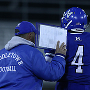 Middletown Quarterback Darius Wade (4) receives the play from Middletown head coach Mark DelPercio in the first quarter of the DIAA State Championship football game against Salesianum Saturday, Nov. 30 2013, at Delaware Stadium in Newark Delaware.