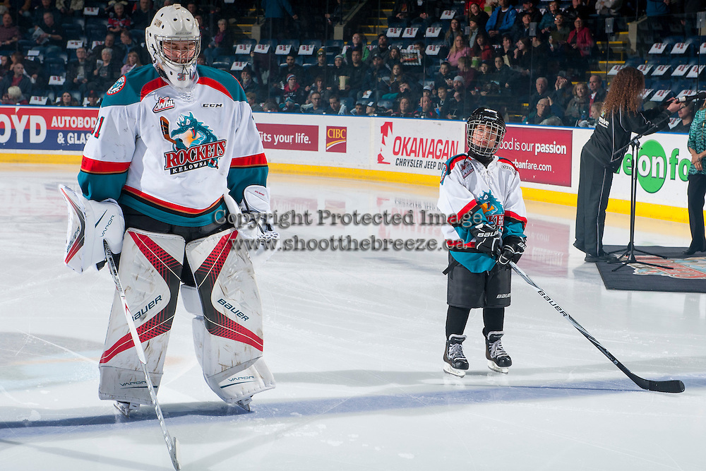 KELOWNA, CANADA - FEBRUARY 10: The Pepsi Save On Foods Player of the game lines up on the blue line next to Brodan Salmond #31 of the Kelowna Rockets against the Vancouver Giants on February 10, 2017 at Prospera Place in Kelowna, British Columbia, Canada.  (Photo by Marissa Baecker/Shoot the Breeze)  *** Local Caption ***