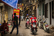 05 APRIL 2012 - HANOI, VIETNAM:   An alley in Hanoi, the capital of Vietnam. The sign advertises Bun, a type of Vietnamese noodle soup.     PHOTO BY JACK KURTZ