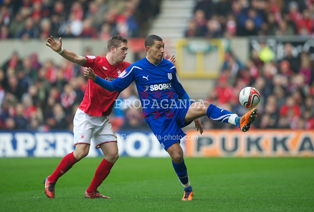 NOTTINGHAM, ENGLAND - Saturday, February 19, 2011: Cardiff City's Jay Bothroyd and Nottingham Forest's Paul Anderson during the Football League Championship match at the City Ground. (Photo by David Rawcliffe/Propaganda)