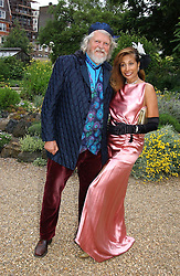 The MARQUESS OF BATH and MISS TRUDI JUGGERNAUT-SHARMA at a fund raising event for The Galapagos Conservation Trust entitled 'Some Enchanted Evening' at the Chelsea Physic Garden Chelsea, London on 17th June 2004.