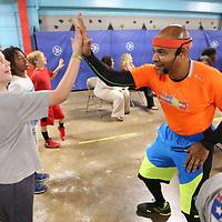 Coach Larry Calhoun gives a high five to Sam Waters, 9, a fourth grader at Rankin Elementary School, during a five munite excersize at Rankin Elementary School as part of Calhoun's Move to Learn program Tuesday mornig in Tupelo.