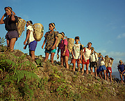 Teenage Nepali boys await the start of a recruitment test for the Gurkha Regiment called the Doko race, part of a tough endurance series to find physically perfect specimens for British army infantry training. They have to carry 30kg of river stones in a traditional Himalayan doko (basket) for 3km up foothills within 37 minutes to pass. 60,000 boys aged between 17-22 (or 25 for those educated enough to become clerks or communications specialists) report to designated recruiting stations in the hills each November, most living from altitudes ranging from 4,000-12,000 feet. After initial selection, 7,000 are accepted for further tests from which 700 are sent down here to Pokhara in the shadow of the Himalayas. Only 160 of the best boys succeed in the journey to the UK. Nepal has been supplying youths for the British army since the Indian Mutiny of 1857.