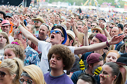 © Licensed to London News Pictures. 14/06/2015. Isle of Wight, UK. Festival goers watching The Courteeners perform at at Isle of Wight Festival 2015 on Sunday Day 4.  This years festival include headline artists the Prodigy, Blur and Fleetwood Mac.  Photo credit : Richard Isaac/LNP