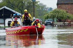 © London News Pictures. 01/05/2012. Tewkesbury, UK. Gloucestershire Fire and Rescue Service launching a boat on to the river Severn at Tewkesbury, Gloucestershire for an exploratory search the river on May 1, 2012, following heavy flooding. Photo credit : Ben Cawthra /LNP