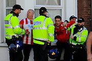 Police dealing with an incident outside St James Park involving Exeter fans before the Sky Bet League 2 match between Exeter City and Plymouth Argyle at St James' Park, Exeter, England on 2 April 2016. Photo by Graham Hunt.