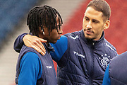 Nikola Katic puts a comforting arm around Joe Aribo of Rangers FC ahead of the Betfred Scottish League Cup semi-final match between Rangers and Heart of Midlothian at Hampden Park, Glasgow, United Kingdom on 3 November 2019.