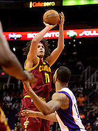 Nov. 09, 2012; Phoenix, AZ, USA; Cleveland Cavaliers center Anderson Varejao (17) puts up a shot against the Phoenix Suns forward Markieff Morris (11) during the first half at US Airways Center. Mandatory Credit: Jennifer Stewart-US PRESSWIRE.