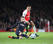 Dinamo Zagreb's Captain Domagoj Antolic battling it out with Arsenal striker Alexis Sanchez during the Champions League match between Arsenal and Dinamo Zagreb at the Emirates Stadium, London, England on 24 November 2015. Photo by Matthew Redman.