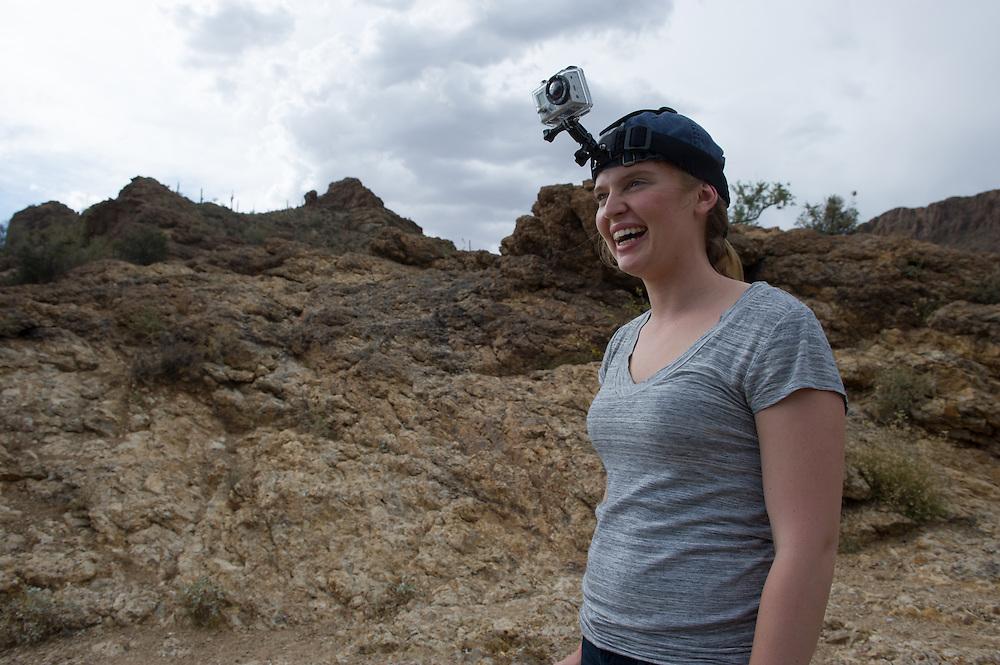 Woman wearing portable GoPro camera on head in desert, Tucson AZ