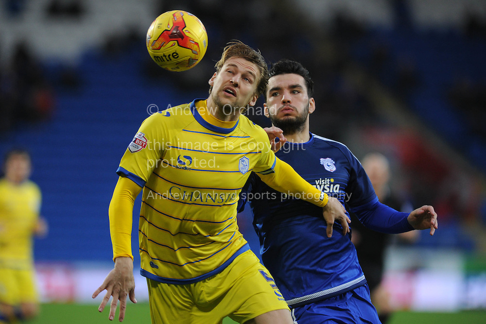 Glen Loovens of Sheffield Wed holds off Tony Watt of Cardiff city &reg;. Skybet football league championship match, Cardiff city v Sheffield Wednesday at the Cardiff city stadium in Cardiff, South Wales on Saturday 12th December 2015.<br /> pic by Andrew Orchard, Andrew Orchard sports photography.