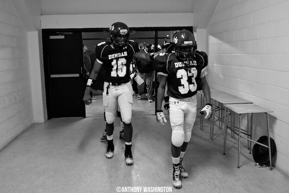Members of Dunbar High School football team head to the locker room during half-time against Mergenthaler Vocational Technical Senior High School on Saturday, September 22, 2012 at Lumsden-Scott Stadium at Baltimore Polytechnic Institute in Baltimore, MD.