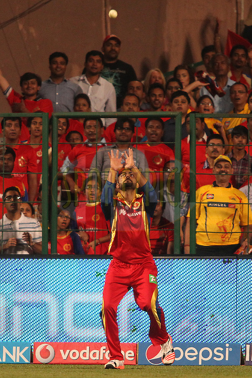 Royal Challengers Bangalore captain Virat Kohli gets under the ball to take the catch to get Ravindra Jadeja of Chennai Super Kings wicket during match 20 of the Pepsi IPL 2015 (Indian Premier League) between The Royal Challengers Bangalore and The Chennai Superkings held at the M. Chinnaswamy Stadium in Bengaluru, India on the 22nd April 2015.<br /> <br /> Photo by:  Shaun Roy / SPORTZPICS / IPL