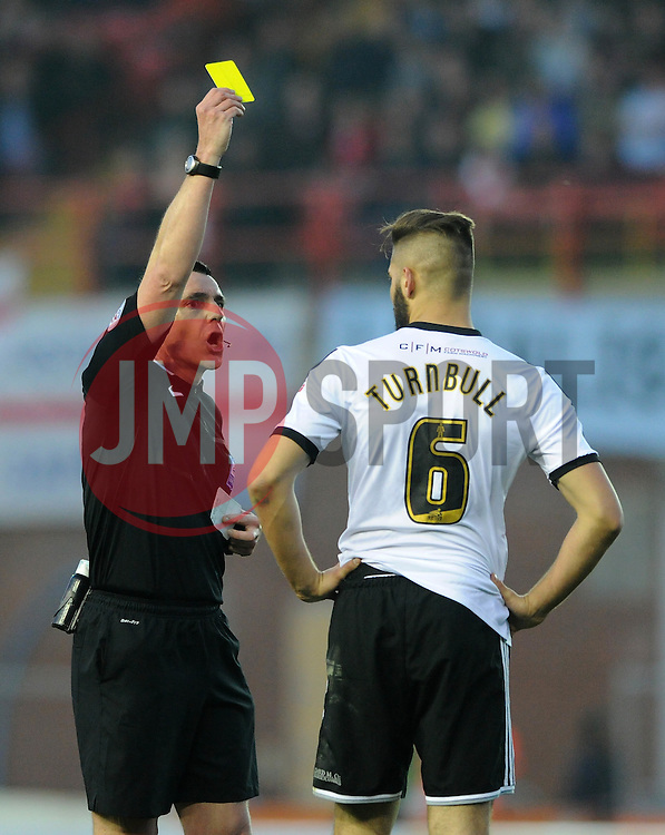Swindon Town's Jordan Turnbull receives a yellow card. - Photo mandatory by-line: Dougie Allward/JMP - Mobile: 07966 386802 - 07/04/2015 - SPORT - Football - Bristol - Ashton Gate - Bristol City v Swindon Town - Sky Bet League One