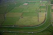 Nederland, Friesland, Gemeente Ferweradeel, 08-09-2009; Noorderleeg (Noarderleech), buitendijks polder en kweldergebied in beheer bij It Fryske Gea (provinciale vereniging voor natuurbescherming). Het gebied is belangrijk als broed-, foerageer- en pleistergebied voor vogels. In het kader van het natuurbeheer experimenteert men met verkweldering van de buitenste zomerpolder, de dijk is gedeeltelijk doorgegraven. Kenmerkend voor het gebied zijn de dobben (dobbe: gegraven poel met drinkwater voor het vee). .Noorderleegte (Northern Void), polders and salt marsh area outside the dikes, managed by It Fryske Gea (Provincial Association for Nature). The area is important for birds (breeding, foraging). As part of the new nature preservation,  the outer dike has been partially dug away allowing for the tides to enter the (former) polders. Caracteristic are the dobben: dug ponds with water for cattle). .luchtfoto (toeslag); aerial photo (additional fee required); .foto Siebe Swart / photo Siebe Swart