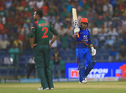 September 20, 2018 - Abu Dhabi, United Arab Emirates - Afghanistan cricketer Rashid Khan celebrates after scoring 50 runs during the 6th cricket match of Asia Cup 2018 between Bangladesh and Afghanistan at the Sheikh Zayed Stadium,Abu Dhabi, United Arab Emirates on September 20, 2018. (Credit Image: © Tharaka Basnayaka/NurPhoto/ZUMA Press)