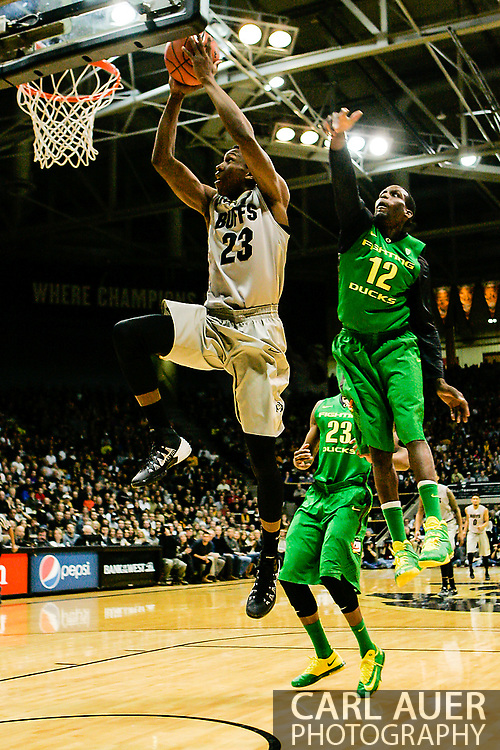 January 5th, 2014:  Colorado Buffaloes freshman guard Jaron Hopkins (23) flies to the hoop for a lay up past Oregon Ducks redshirt senior guard Jason Calliste (12) in first half action of the NCAA Basketball game between the Oregon Ducks and the University of Colorado Buffaloes at the Coors Events Center in Boulder, Colorado
