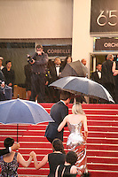 Diane Kruger walking up the red steps in the rain at the gala screening of Amour at the 65th Cannes Film Festival. Sunday 20th May 2012 in Cannes Film Festival, France.