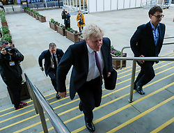 (c) Licensed to London News Pictures. <br /> 04/10/2017<br /> Manchester, UK<br /> <br /> Foreign Secretary Boris Johnson MP walks from the Midland Hotel to visit the displays in the exhibition hall at the Conservative Party Conference held at the Manchester Central Convention Complex.<br /> <br /> Photo Credit: Ian Forsyth/LNP