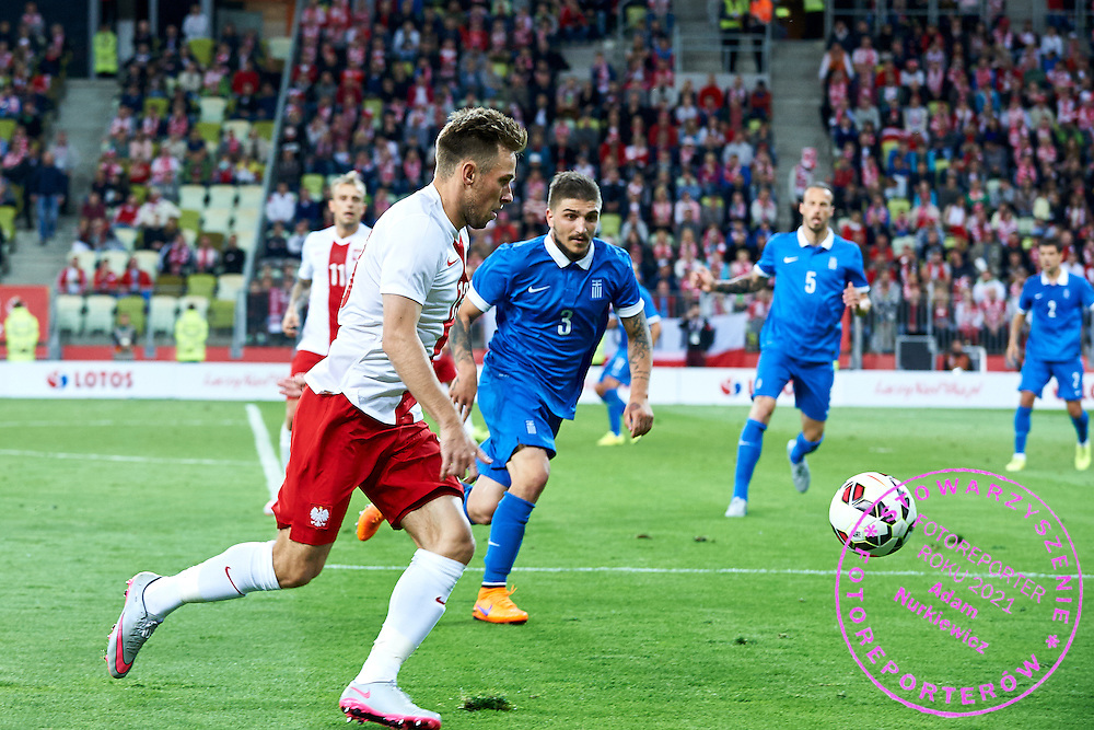 (L) Maciej Rybus from Poland fights for the ball with (R) Kostas Stafylidis from Greece during international friendly soccer match between Poland and Greece at PGE Arena Stadium on June 16, 2015 in Gdansk, Poland.<br /> Poland, Gdansk, June 16, 2015<br /> <br /> Picture also available in RAW (NEF) or TIFF format on special request.<br /> <br /> For editorial use only. Any commercial or promotional use requires permission.<br /> <br /> Adam Nurkiewicz declares that he has no rights to the image of people at the photographs of his authorship.<br /> <br /> Mandatory credit:<br /> Photo by &copy; Adam Nurkiewicz / Mediasport