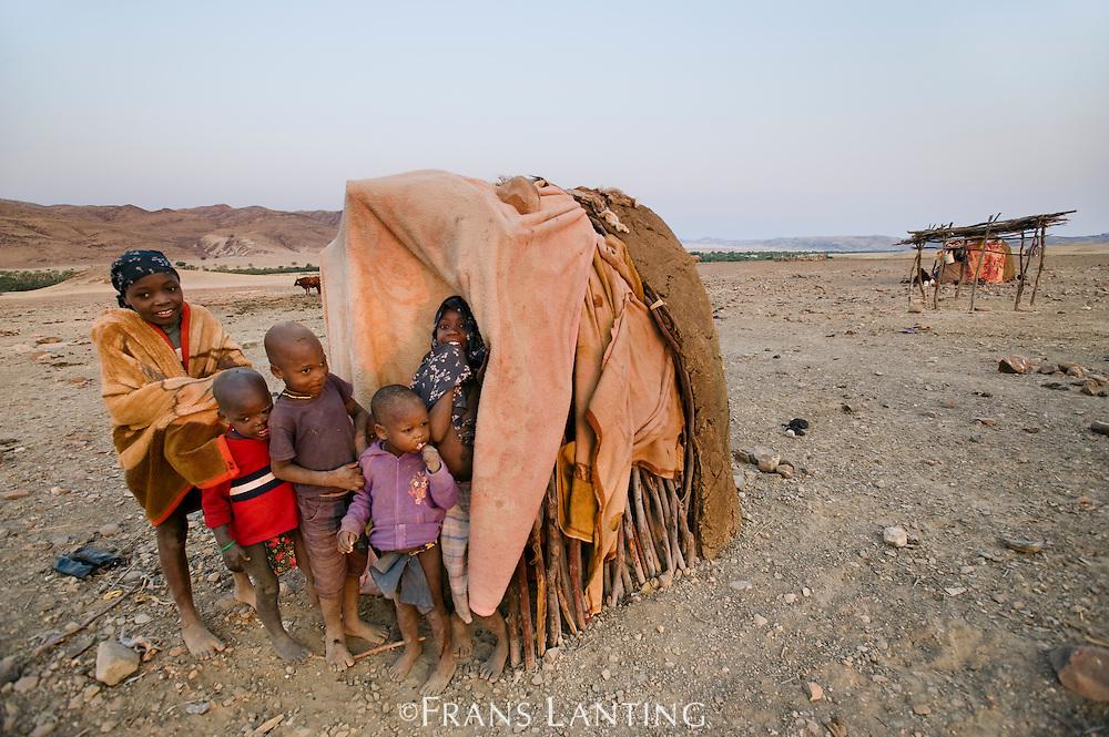 Himba children at hut, Puros Conservancy, Damaraland, Namibia