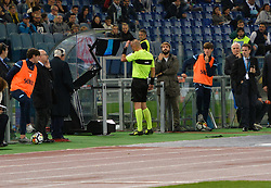 October 22, 2017 - Rome, Italy - the referee consults the VAR monitor during the Italian Serie A football match between S.S. Lazio and Cagliari at the Olympic Stadium in Rome, on october 22, 2017. (Credit Image: © Silvia Lore/NurPhoto via ZUMA Press)