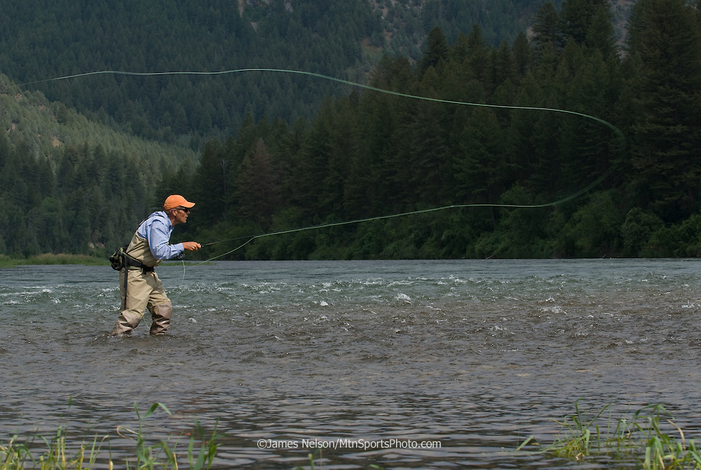 An angler casts a fly for trout in the canyon section of the South Fork of the Snake River, Idaho.