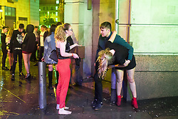 "© Licensed to London News Pictures . 23/12/2017. Manchester, UK. A man supports a woman against a wall outside the Printworks in Manchester City Centre overnight during "" Mad Friday "" , named for being one of the busiest nights of the year for the emergency services in the UK . Photo credit: Joel Goodman/LNP"