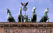 Atop the Brandenburg Gate, the four horse driven chariot and Victoria, the Roman goddess of victory.