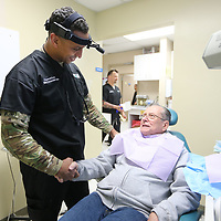 Dr. Abby Raymond meets with patient Roger Peloquin, of Aberdeen, before having his dental work done on Monday. Peloquin is a US Navy Veteran that served in Vietnam.