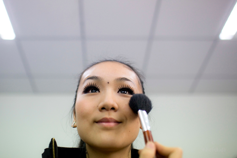 "A participant of ""Miss. International"" beauty contest puts on makeup before the show in Beijing, China, Nov. 7, 2009."