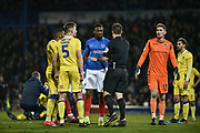 The ref talks to Portsmouth Forward, Omar Bogle (22) after a clash with Bristol Rovers Defender, Tom Lockyer (4) during the EFL Sky Bet League 1 match between Portsmouth and Bristol Rovers at Fratton Park, Portsmouth, England on 19 February 2019.