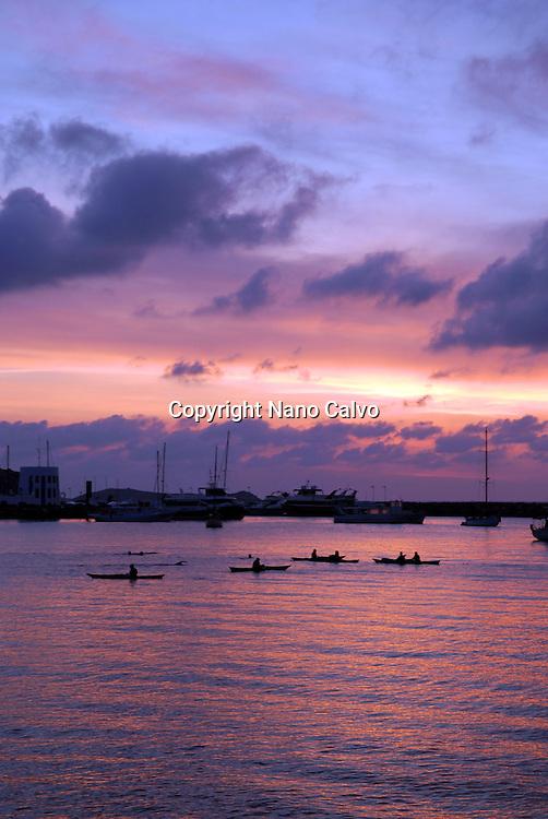 Group of kayaks at sunrise