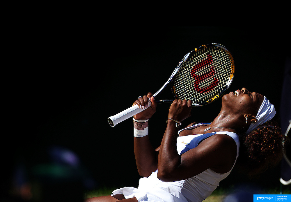 Serena Williams, USA, falls to her knees as she celebrates her victory over sister Venus Williams, USA, during the Ladies Singles Final at the All England Lawn Tennis Championships at Wimbledon, London, England on Saturday, July 04, 2009. Photo Tim Clayton