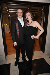 CAMILLA RUTHERFORD and DOMINIC BURNS at a dinner hosted by jewellers Damiani at The Connaught Hotel, London on 3rd February 2010.