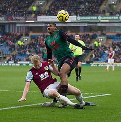 Ben Mee of Burnley (L) tackles Wesley of Aston Villa causing injury - Mandatory by-line: Jack Phillips/JMP - 01/01/2020 - FOOTBALL - Turf Moor - Burnley, England - Burnley v Aston Villa - English Premier League