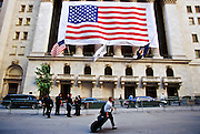 NEW YORK, NY: A  person walks past the New York Stock Exchange up Wall Street  with his suitcase after being evacuated from his condo near the World Trade Center after the terrorist attack on the WTC, Sept. 22, 2001. More than 2,900 people were killed when terrorists crashed two airliners into the towers on Sept. 11, 2001. Thousands of people who live in Battery Park City and lower Manhattan have been forced to leave their homes because of the destruction and resulting mess following the attack on the WTC. PHOTO BY JACK KURTZ